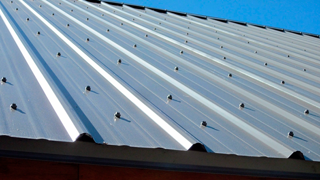 Exposed fasteners are the most budget-friendly metal roofing style.