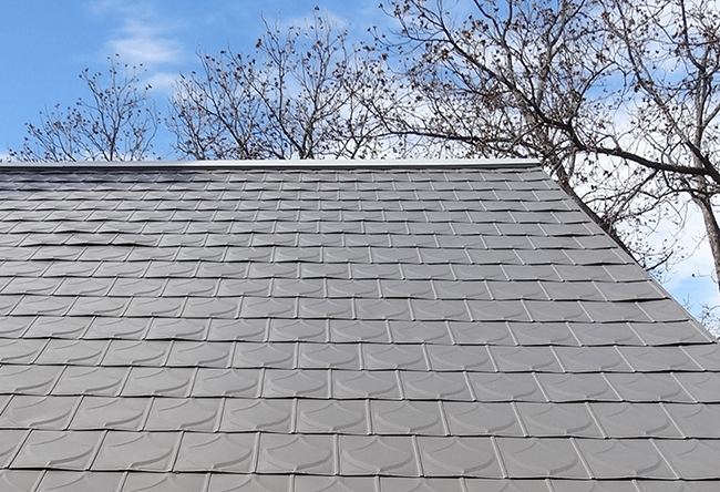 Stamped metal shingles resemble the look of shingles, shake, tile, and slate roofing.